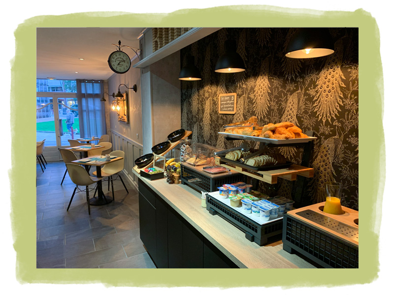 The simple and warm decoration of our breakfast space with air conditioning